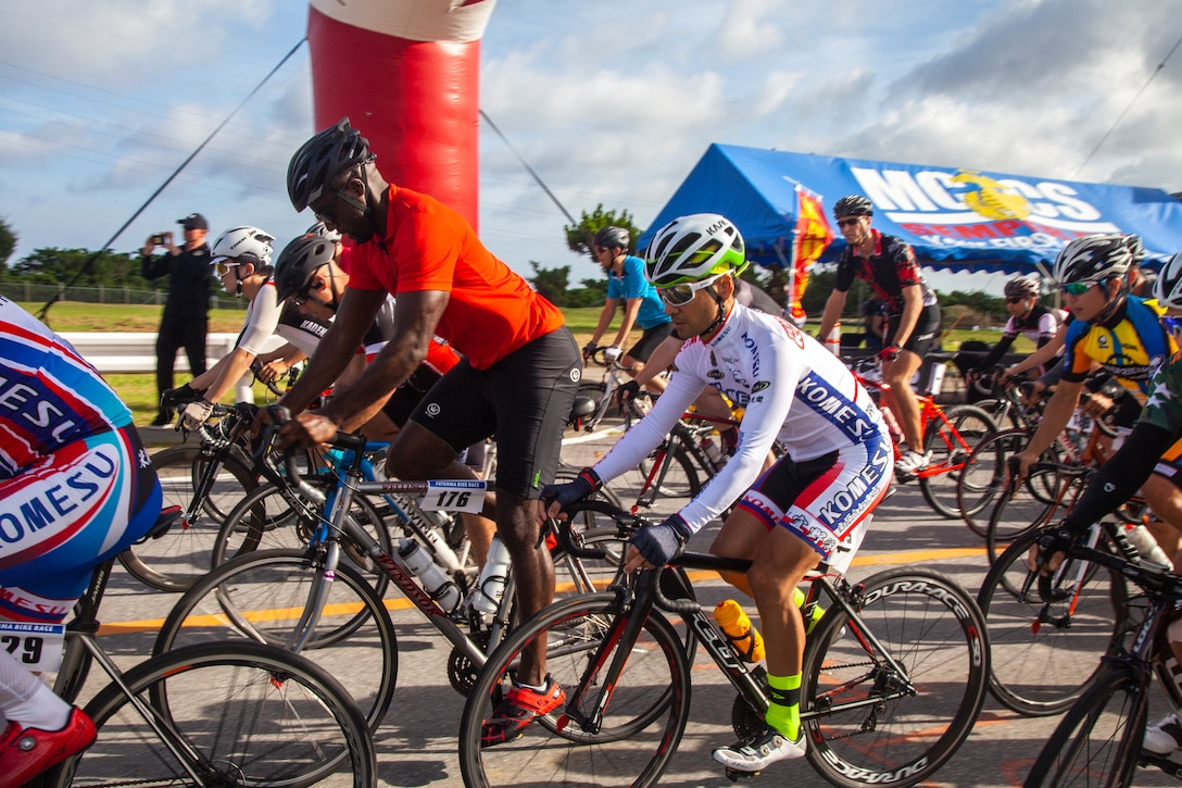 Status of Forces Agreement personnel and Okinawan residents begin the 2019 Futenma Bike Race on Marine Corps Air Station Futenma, Okinawa, Japan, July 14, 2019. The race invites Status of Forces Agreement personnel and the local Okinawan community to compete in race on and around MCAS Futenma's airfield.