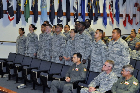 Reserve Citizen Airmen stand as they are recognized during an induction ceremony before reciting the oath of the noncommissioned officer July 13, 2019 at the Robert D. Gaylor NCO Academy, Joint Base San Antonio-Lackland, Texas.