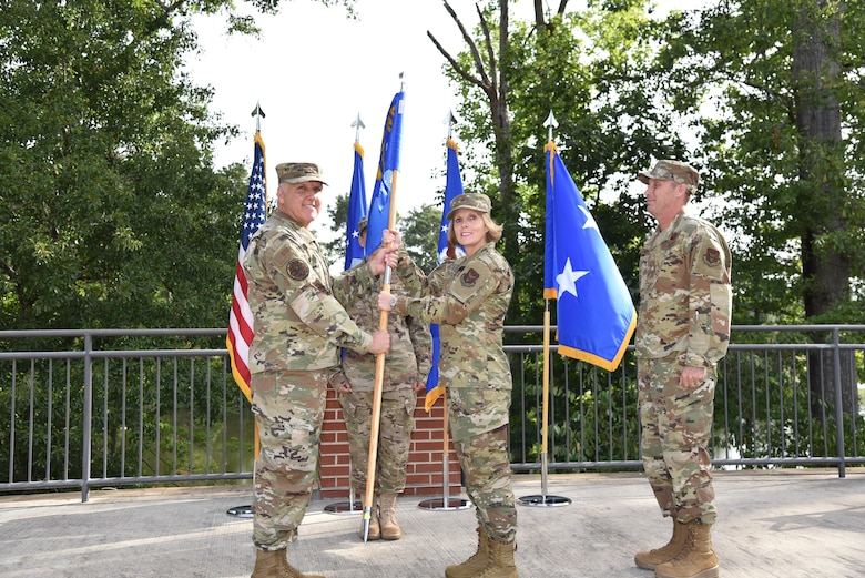"Maj. Gen. John ""Jay"" Flournoy Jr. passes the guidon to Brig. Gen. Stacey L. Scarisbrick suring a change of command ceremony on Robins Air Force Base in Georgia on July 15. Scarisbrick takes command of the Air Force Reserve Command Force Generation Center relieving Brig. Gen. Matthew J. Burger. (U.S. Air Force photo by Misuzu Allen)"