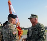 Maj. Gen. Daniel R. Walrath, incoming U.S. Army South commander, accepts the Army South colors from Adm. Craig Faller, U.S. Southern Command Commander, providing him with the authority of command, and ceremonially recognizing him as the commander of U.S. Army South, during a change of command ceremony at Joint Base San Antonio-Fort Sam Houston July 15.