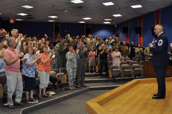 Chief Master Sgt. Joseph Salomon, 433rd Maintenance Group superintendent, receives a standing ovation during his retirement ceremony July 13, 2019 at Joint Base San Antonio-Lackland, Texas.