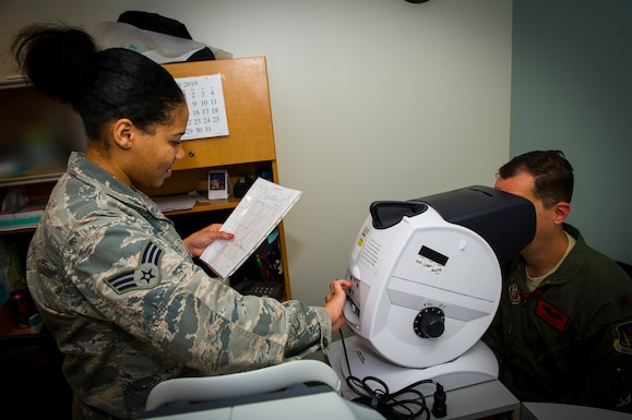 U.S. Air Force Senior Airman Rayne Patton, 926th Aerospace Medicine Squadron optical technician, reads a visual chart to a patient inside the medical clinic, July 13, 2019 at Nellis Air Force Base, Nev. The 926 AMDS works cohesively to ensure all Reserve personnel assigned are medically and operationally ready to fulfill the wing's mission. (U.S. Air Force photo/Senior Airman Brett Clashman)