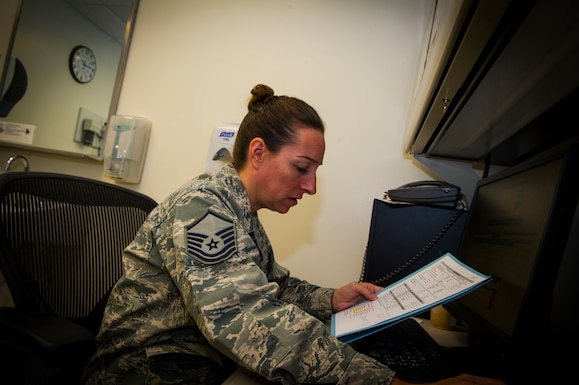 U.S. Air Force Master Sgt. Chrystal Myers, 926th Aerospace Medicine Squadron medical technician, reviews medical records for a patient inside the medical clinic, July 13, 2019 at Nellis Air Force Base, Nev. The 926 AMDS provides direct medical support to Reserve Airmen to maintain operational readiness. (U.S. Air Force photo/Senior Airman Brett Clashman)