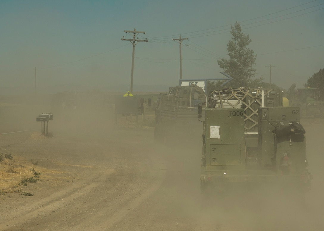 A U.S. Air Force convoy of 5-ton trucks from the 726th Air Control Squadron transports a variety of equipment July 14, 2019, near Mountain Home Air Force Base, Idaho. This convoy was in support of Hardrock Exercise 19-2, where supplies on the truck enabled the 726th ACS Airmen to set up an entirely self-sufficient base in a simulated remote location. (U.S. Air Force photo by Airman 1st Class Andrew Kobialka)