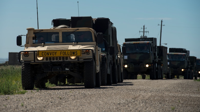 A U.S. Air Force convoy of 5-ton trucks from the 726th Air Control Squadron transports a variety of equipment July 14, 2019, near Mountain Home Air Force Base, Idaho. This convoy was in support of Hardrock Exercise 19-2, where supplies on the truck enabled the 726th ACS Airmen to set up an entirely self-sufficient base in a simulated remote location. (U.S. Air Force photo by Senior Airman JaNae Capuno)