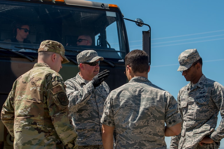 Tech. Sgt. Joshua Kelly, 726th Air Control Squadron NCO in charge of power production, briefs the Mobile Operating Air Base (MOAB) setup to other U.S. Air Force Airmen July 14, 2019, at Mountain Home Air Force Base, Idaho. This convoy was in support of Hardrock Exercise 19-2, where supplies on the truck enabled the 726th ACS Airmen to set up an entirely self-sufficient base in a simulated remote location. (U.S. Air Force photo by Senior Airman JaNae Capuno)