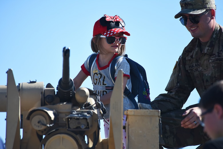 "A child tours an armored tank July 13, 2019, at the ""Mission Over Malmstrom"" open house event on Malmstrom Air Force Base, Mont."