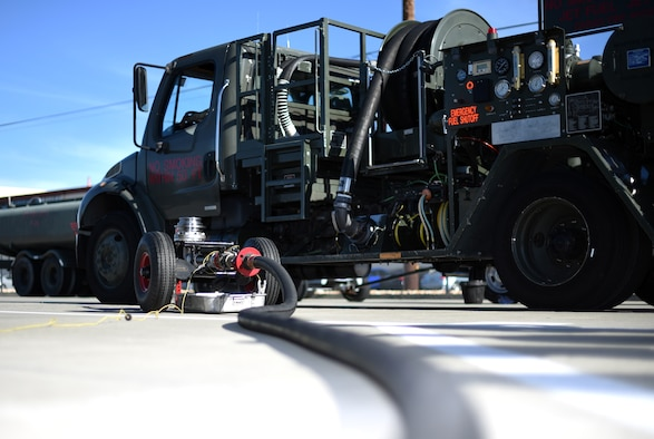 A prototype mobile fuel pressurizer sits ready for use beside a 60th Logistics Readiness Squadron fuel truck July 10, 2019, at Travis Air Force Base, California. The prototype has been proven to cut man hours for the fuel pressurization process from two hours to 45 minutes and is the brainchild of U.S. Air Force Senior Airman Tanner O'Laughlin, 60th LRS fuels distribution operator. (U.S. Air Force photo by Senior Airman Christian Conrad)