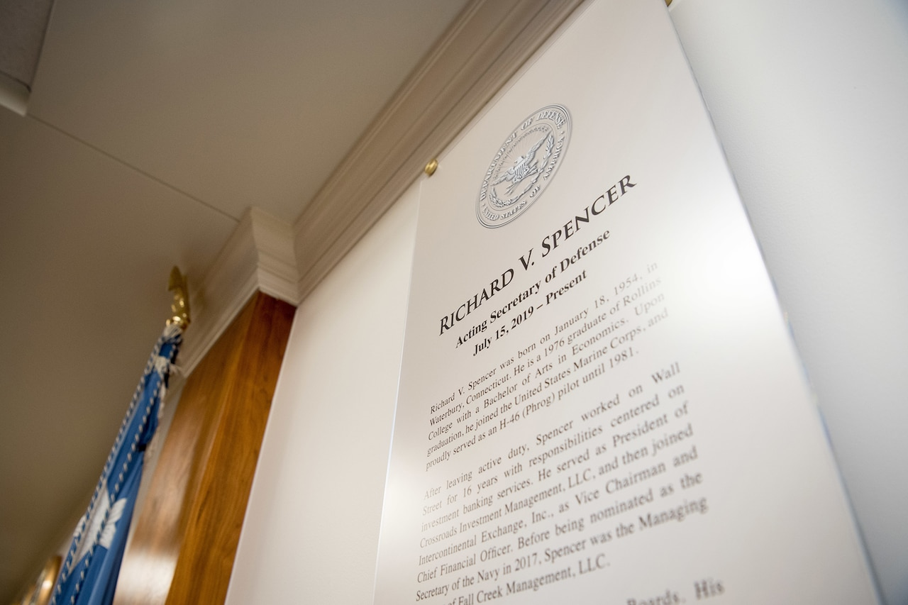 Acting Defense Secretary Richard V. Spencer's biography is displayed.