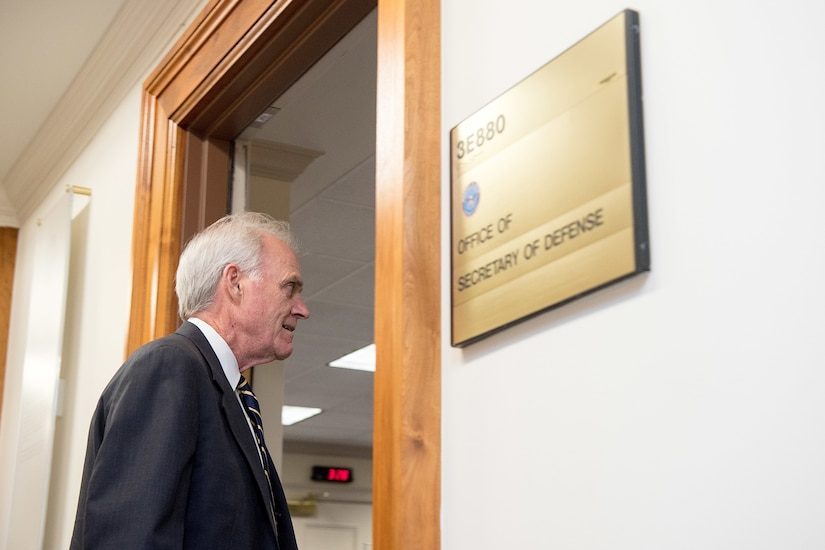 Acting Defense Secretary Richard V. Spencer walks through a doorway.