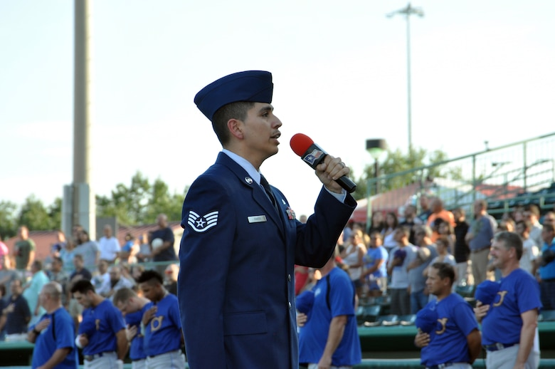 "Staff Sgt. Joshua A. Ramos, 433rd Airlift Wing command post controller, sings the ""The Star Spangled Banner"" at the San Antonio Missions baseball team's 433rd Airlift Wing Night game July 13, 2019 at Nelson W. Wolff Municipal Stadium."