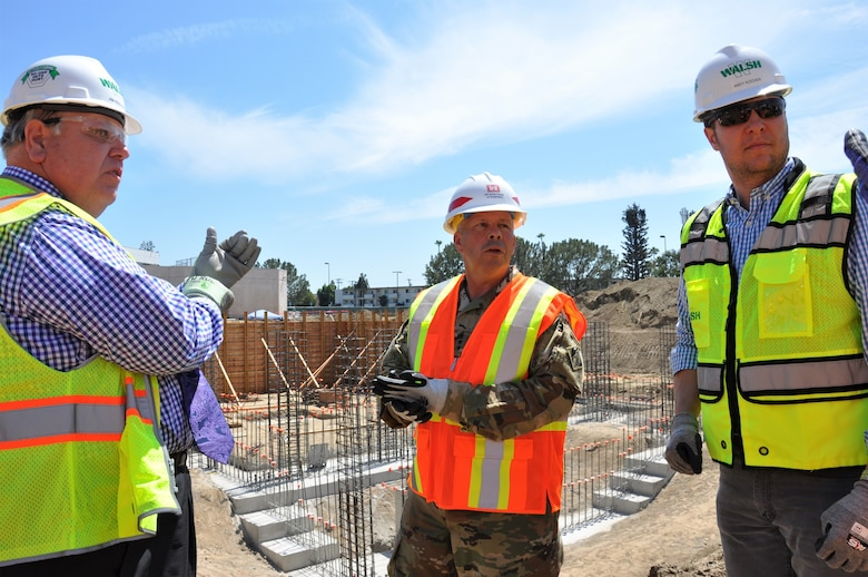 Lt. Gen. Todd T. Semonite, U.S. Army Corps of Engineers commanding general, center, receives an update about the Corps' Long Beach Veterans Affairs Healthcare System project from the Corps' contractor, Walsh Construction, during a July 9 visit to the medical center in Long Beach, California. The Corps is constructing a five-phase, $317-million-project at the Long Beach VA Healthcare System Medical Center, which includes a mental health in-patient/out-patient facility, community living center, parking structure, combined heat-and-power generation plant and demolition of the existing mental health and community living center buildings.