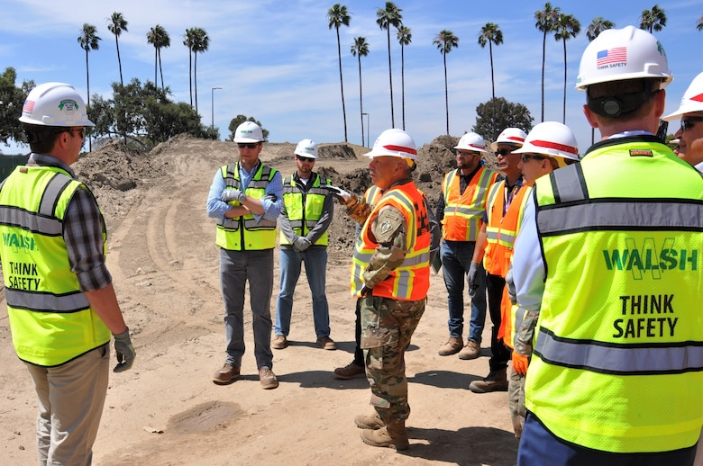 Lt. Gen. Todd T. Semonite, U.S. Army Corps of Engineers commanding general, center, talks to engineers and project managers with the Corps and its contractor, Walsh Construction, during a July 9 site visit to the Long Beach VA Healthcare System Medical Center in Long Beach, California. The Corps is constructing a five-phase, $317-million-project at the center, which includes a mental health in-patient/out-patient facility, community living center, parking structure, combined heat-and-power generation plant and demolition of the existing mental health and community living center buildings.