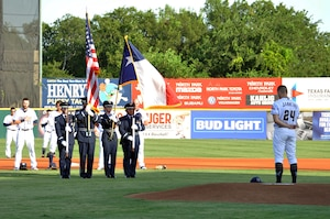 The 433rd Airlift Wing Honor Guard performs a flag ceremony at the San Antonio Missions baseball team's 433rd Airlift Wing Night game July 13, 2019 at Nelson W. Wolff Municipal Stadium.