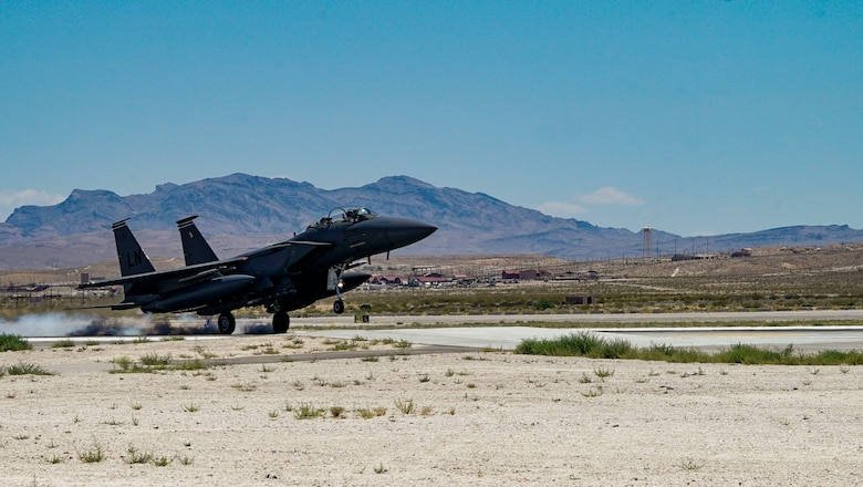 An F-15E Strike Eagle assigned to the 48th Fighter Wing at RAF Lakenheath lands at Nellis Air Force Base for Red Flag 19-3. Red Flag provides aircrews the experience of multiple, intensive air combat sorties in the safety of a training environment. (U.S. Air Force photo by Senior Airman Julian W. Kemper)
