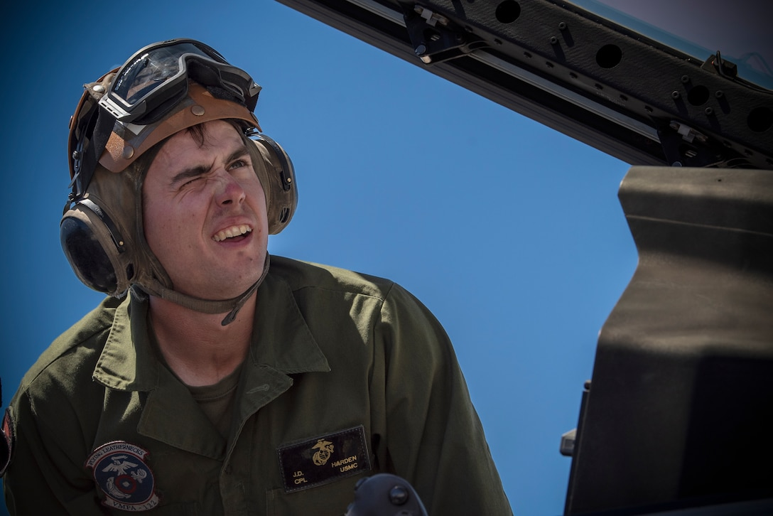 Cpl. J.D. Harden, an aviation mechanic assigned to Marine Fighter Attack Squadron 122, out of Marine Corps Air Station Yuma, Arizona, performs pre-flight checks on a F-35B Lightning II fighter jet on the flighline at Nellis Air Force Base, Nev., July 15, 2019. Harden and his squadron are assigned the role of strike for Red Flag 19-3 at Nellis. (U.S. Air Force Photo by Airman 1st Class Dwane R. Young)