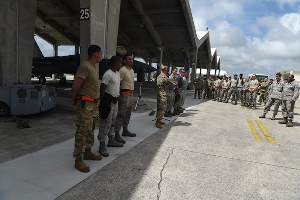 U.S. Air Force Airmen from the 67th Aircraft Maintenance Unit and the 44th Aircraft Maintanence Unit compete in the weapons load crew competition at Kadena Air Base, Japan, July 1, 2019. The weapons load competition is held between the 67th and 44th AMUs to determine the best weapons load crew members on Kadena.