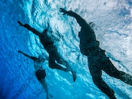 U.S. Marines with radio reconnaissance platoon, 3rd Radio Battalion, conduct a front crawl stroke during a pool training event, Marine Corps Base Hawaii, June 28, 2019. The advanced water survival training is part of a broader curriculum that aims to maintain the readiness of the unit's current radio reconnaissance operators, as well as prepare prospective radio reconnaissance team members for the requirements of basic reconnaissance course. (U.S. Marine Corps photo by Cpl. Luke Kuennen)