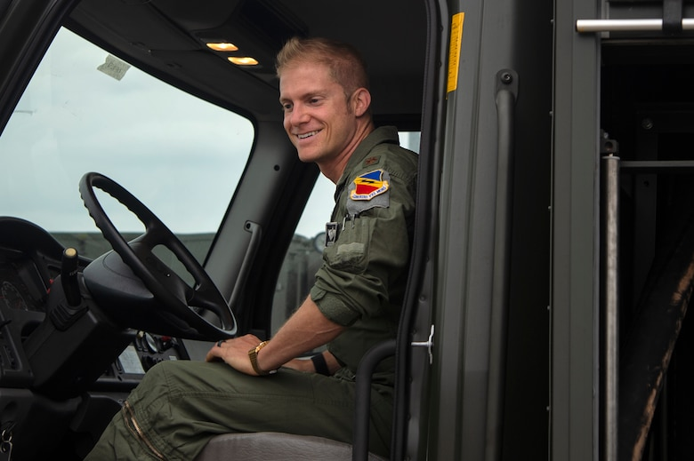 U.S. Air Force Maj. Michael Slotten, 421st Fighter Squadron F-35A Lightning II pilot, sits in a fuel truck at Spangdahlem Air Base, Germany, July 11, 2019. Slotten was stationed at Spangdahlem from 2004 to 2006 as an Airman first class fuels distributor operator. This was his first time driving a fuels truck since commissioning in 2008. (U.S. Air Force photo by Airman 1st Class Valerie Seelye)