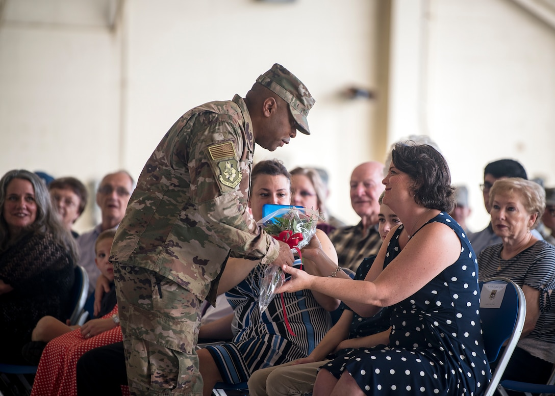 Catherine Cook, right, wife of Col. Gerald Cook, 476th Fighter Group commander, receives a bouquet of flowers during a change of command ceremony, July 14, 2019, at Moody Air Force Base, Ga. The ceremony is a military tradition that represents a formal transfer of a unit's authority and responsibility from one commander to another. (U.S. Air Force photo by Airman 1st Class Eugene Oliver)
