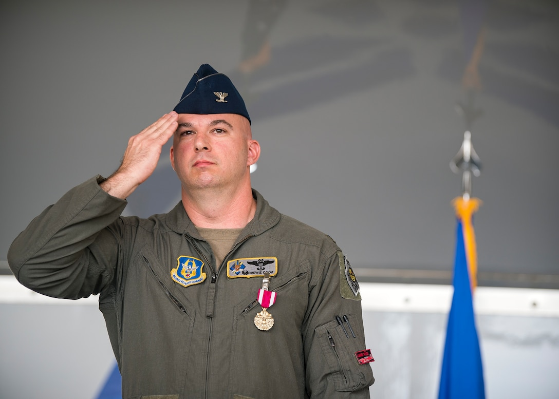 Col. Gerald Cook, 476th Fighter Group (FG) commander, renders a final salute to the Airmen of the 476th FG during a change of command ceremony, July 14, 2019, at Moody Air Force Base (AFB), Ga. The ceremony is a military tradition that represents a formal transfer of a unit's authority and responsibility from one commander to another. Cook will depart Moody AFB to attend the National War College in Washington D.C. (U.S. Air Force photo by Airman 1st Class Eugene Oliver)