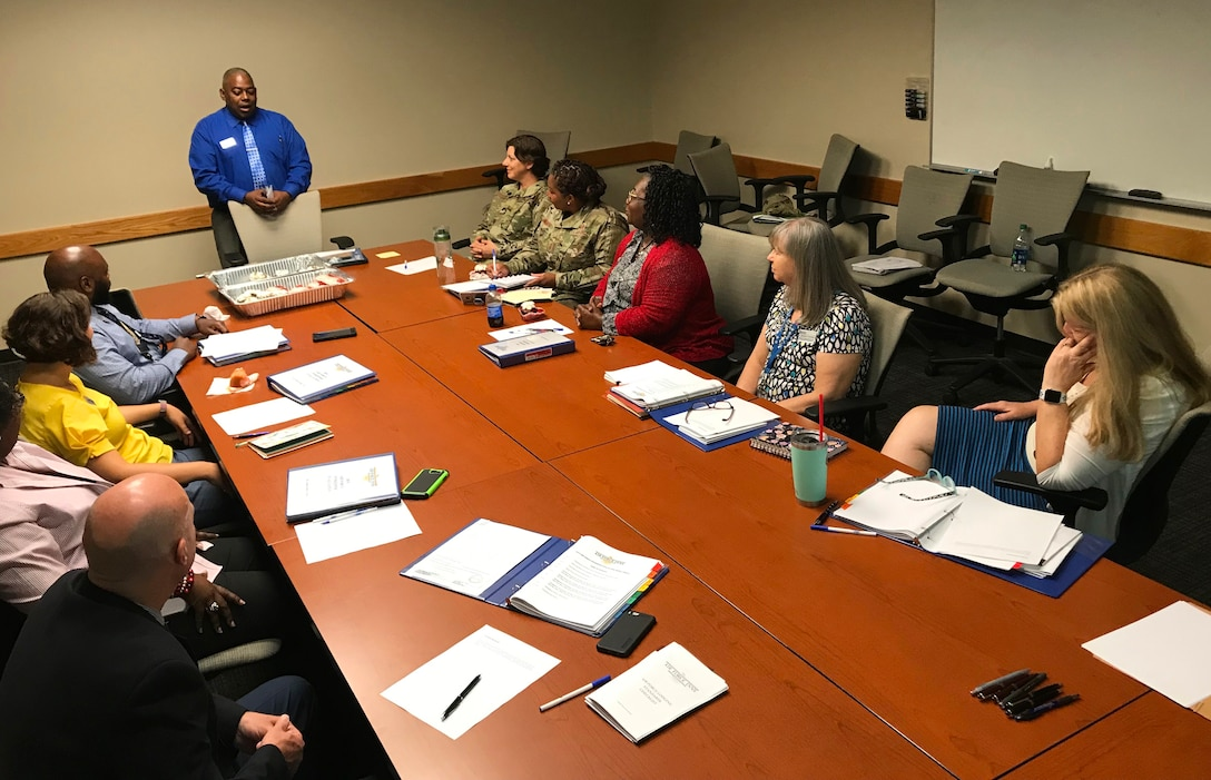 Air Force Services Center Lodging Management Specialist Daran Steele leads a discussion on Innkeeper Award evaluations in a final meeting before teams began their base visits. Seven installations -- three large and four small -- are in the running for this year's Innkeeper Awards. (U.S. Air Force photo by Armando Perez)