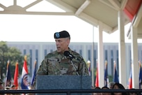 A military leader speaks at a podium.