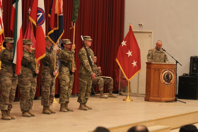 Major Gen. Ben Corell, commanding general, 34th Red Bull Infantry Division, Minnesota Army National Guard, highlights the accomplishments of the Red Bull Division and Task Force Spartan during the a transfer of authority ceremony at Camp Arifjan, Kuwait, July 15, 2019. The ceremony marked the transfer of mission command between the outgoing Red Bull Division and the incoming 38th Infantry Division, Indiana Army National Guard.