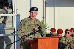U.S. Army Maj. Gen. John P. Sullivan, commander of the 1st Theater Sustainment Command, addresses service members and civilians of the Multinational Force and Observers (MFO) during a change of command on the parade square at South Camp, Sinai, Egypt, July 15, 2019.