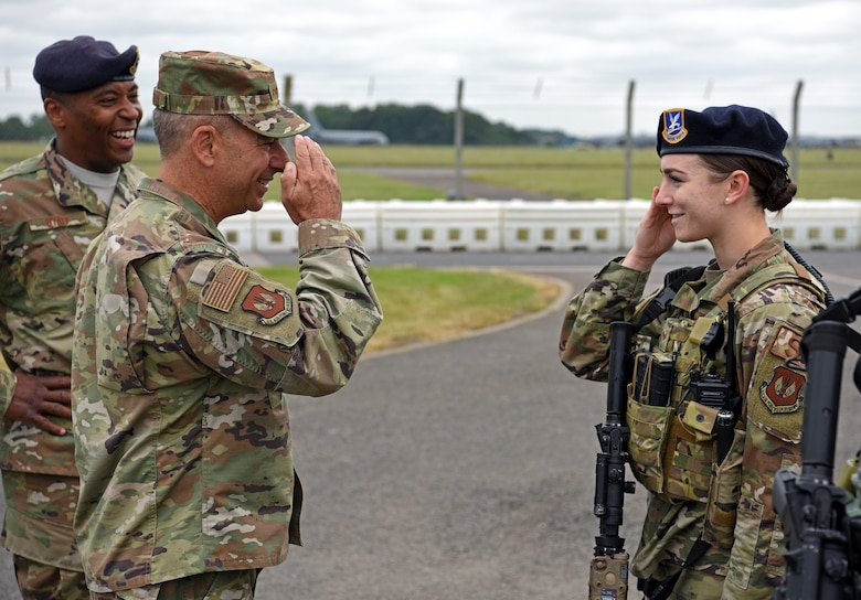 U.S. Air Force Gen. Jeff Harrigian, U.S. Air Forces in Europe – Air Forces Africa commander, salutes Senior Airman Sadie Gulley, 100th Security Forces Squadron member, after receiving a security briefing at RAF Mildenhall, England, July 15, 2019. During the visit, Harrigian discussed how crucial RAF Mildenhall is to our allies all over the region. (U.S. Air Force photo by Airman 1st Class Brandon Esau)