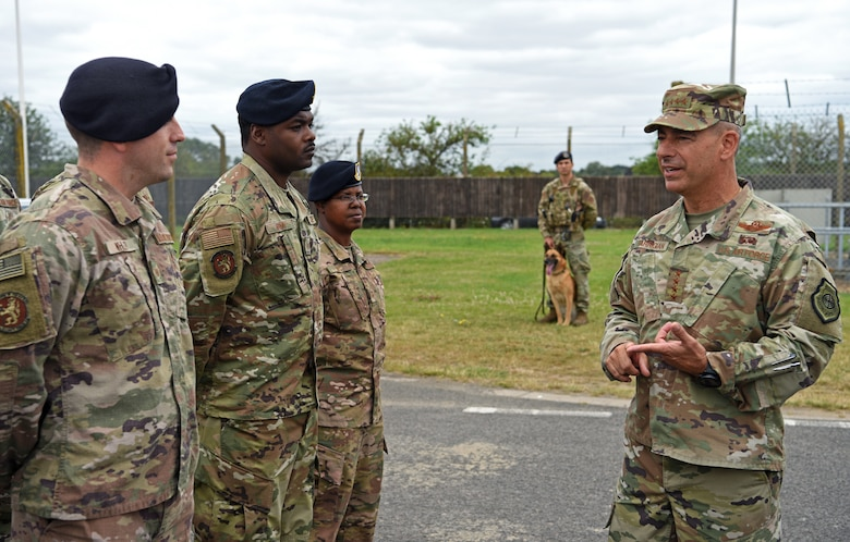 U.S. Air Force Gen. Jeff Harrigian, U.S. Air Forces in Europe – Air Forces Africa commander, discusses security measures with members of the 100th Security Forces Squadron at RAF Mildenhall, England, July 15, 2019. Harrigian made his first visit to RAF Mildenhall since assuming command in May 2019, speaking to Airmen on the importance of their mission and highlighting his vision. (U.S. Air Force photo by Airman 1st Class Brandon Esau)