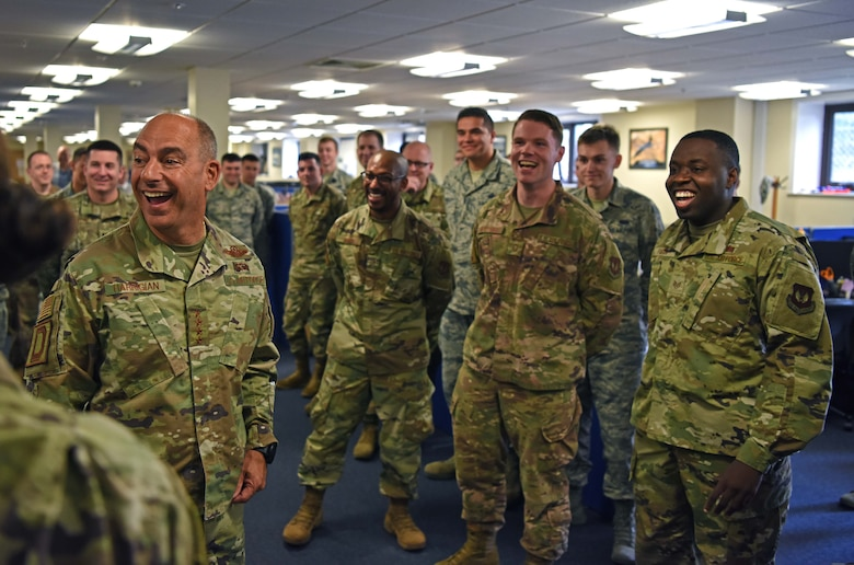 U.S. Air Force Gen. Jeff Harrigian, U.S. Air Forces in Europe – Air Forces Africa commander, shares a laugh with members of the 100th Communications Squadron during his visit to RAF Mildenhall, England, July 15, 2019. During the visit, Harrigian introduced his three priorities as USAFE-AFAFRICA commander – readiness, posture and partnerships. (U.S. Air Force photo by Airman 1st Class Brandon Esau)