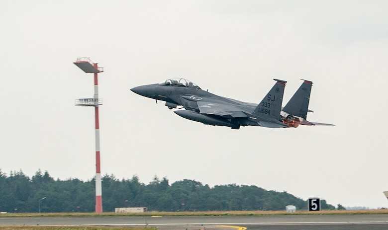 A U.S. Air Force F-15E Strike Eagle, assigned to the 4th Fighter Wing, Seymour Johnson Air Force Base, North Carolina, takes off at Spangdahlem Air Base, Germany, July 16, 2019, during Operation Rapid Forge. Rapid Forge aircraft are forward deploying to bases in the territory of NATO allies in order to enhance readiness and improve interoperability. The goal of the operation is to enhance readiness in coordination with U.S. allies and partners in Europe. (U.S. Air Force photo by Airman 1st Class Kyle Cope)