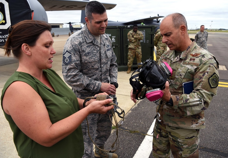 U.S. Air Force Gen. Jeff Harrigian, U.S. Air Forces in Europe – Air Forces Africa commander, is shown an Integrated Communication Respirator by Master Sgt. William Bell, 100th Maintenance Squadron accessories flight chief, and Mia Tobitt, 100th MXS Continuous Process Improvement manager, during a visit to RAF Mildenhall, England, July 15, 2019. During the visit, Harrigian stressed the importance of strengthening partnerships through various exercises and a shared, common goal. (U.S. Air Force photo by Airman 1st Class Brandon Esau)