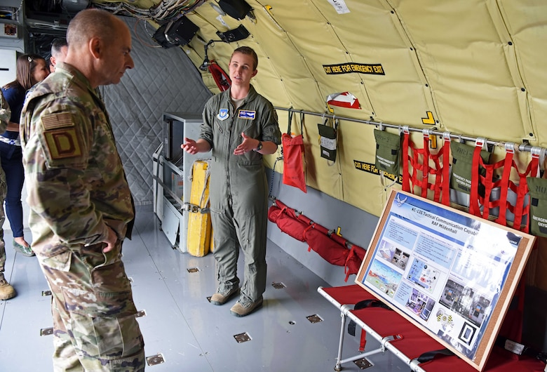 """U.S. Air Force Gen. Jeff Harrigian, U.S. Air Forces in Europe – Air Forces Africa commander, receives a KC-135 Stratotanker briefing from Capt. Marissa """"Doom"""" Strauss, 351st Air Refueling Squadron weapons officer, during a visit to RAF Mildenhall, England, July 15, 2019. During the visit, Harrigian introduced his three priorities as USAFE-AFAFRICA commander – readiness, posture and partnerships. (U.S. Air Force photo by Airman 1st Class Brandon Esau)"""