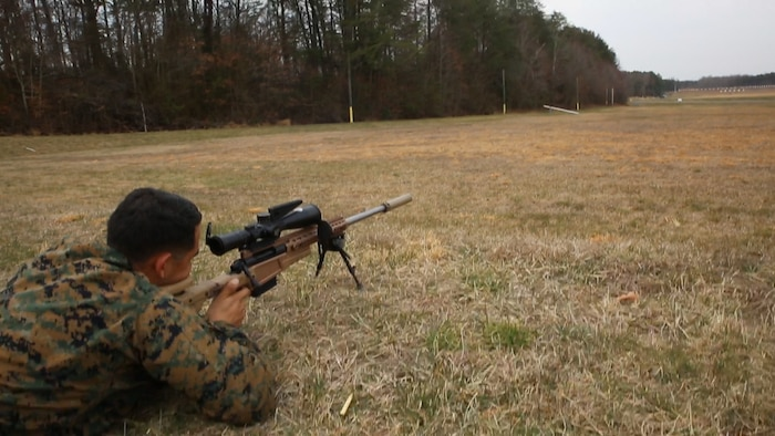 Sgt. Randy Robles, Quantico Scout Sniper School instructor and Marine Corps Systems Command liaison, demonstrates the MK13 Mod 7 Sniper Rifle during training March 29, 2018, aboard Marine Corps Base Quantico, Virginia. The system, which reached full operational capability in the second quarter of fiscal year 2019, shoots a more accurate bullet at greater distances than the legacy sniper rifle. Marines will primarily use the MK13 during deployments, while the M40A6 legacy rifle will be used for sniper training. (U.S. Marine Corps photo by Kristen Murphy)