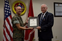 Robert Andrew was awarded the Navy-Civilian Meritorious Service Medal after spending his last two years at U.S. Marine Corps Forces, South as the political advisor, July 11, 2019.