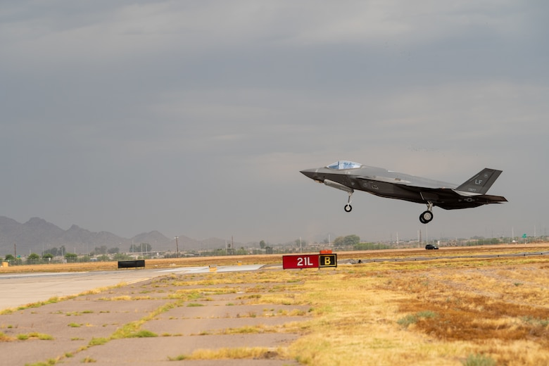 An F-35A Lightning II assigned to the 63rd Fighter Squadron lands during a storm July 12, 2019, at Luke Air Force Base, Ariz. Every summer, Luke combats monsoon season, which consist of torrential downpours and sandstorms making it one of the harshest training environments in the United States. (U.S. Air Force photo by Airman 1st Class Aspen Reid)