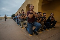 New recruits with Kilo Company, 3rd Recruit training Battalion respond to a drill instructor during a Uniform Code of Military Justice brief at Marine Corps Recruit Depot San Diego, July 8.