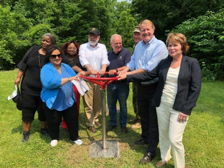 PITTSBURGH – After days of heavy rain and storms in the area, the sun shined brightly on the ribbon cutting, or more correctly stated, valve-turning ceremony for the completion of the Sheraden Park Aquatic Ecosystem Restoration Project, June 1.