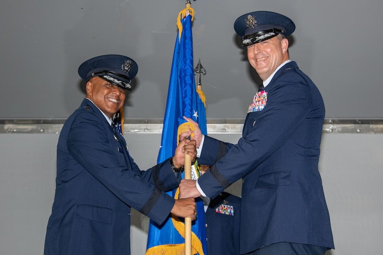 Lieutenant Gen. Anthony Cotton, Air University commander, presents the unit flag for the Curtis E. LeMay Center for Doctrine Development and Education to Maj. Gen. Brad Sullivan, who took command of the center on July 15, 2019, at a change of command ceremony on Maxwell Air Force Base, Alabama. In his position as the LeMay Center commander, Sullivan also serves as the vice commander of Air University.
