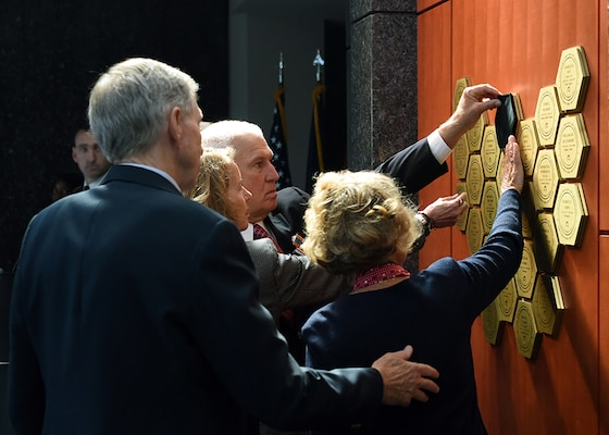 The family of Scott Wirtz removed the black cloth uncovering his name plaque, memorialized on the DIA Patriots Memorial wall.