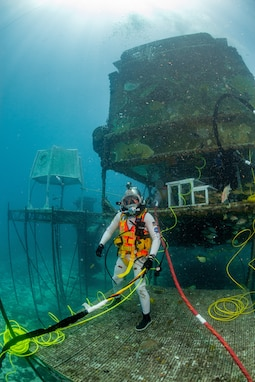 David Coan, extra vehicular activity lead for the National Aeronautics and Space Administration (NASA) Johnson Space Center dives at the Aquarius Reef Base underwater habitat.donning a Kirby Morgan-37 helmet equipped with the Divers Augmented Vision Device Generation 1.0 heads-up display during the 23rd NASA Extreme Environment Mission Operations in June 2019.