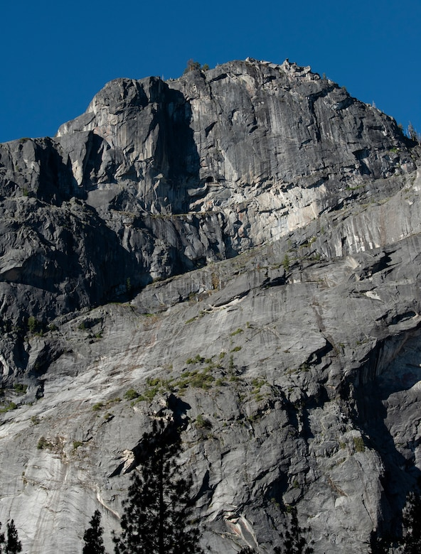 One of the many peaks people can climb is visible from the valley floor July 13, 2019, at Yosemite National Park. Nearly four dozen U.S. Air Force Airmen from Travis Air Force Base, California, participated in a 14.57 mile hike to Cloud's Rest, 9,926 feet above sea level. The hike was organized to enhance the Airmen's physical, mental and spiritual resiliency. (U.S. Air Fore photo by Tech. Sgt. James Hodgman)