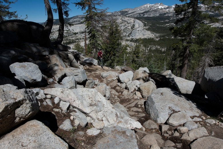 U.S. Air Force Staff Sgt. Jarret Redhair, 22nd Airlift Squadron C-5M Super Galaxy flight engineer, waits for his hiking partner July 13, 2019, at Yosemite National Park, California. Nearly four dozen Airmen from Travis Air Force Base, California, hiked to Cloud's Rest covering 14.57 miles as they climbed to 9,926 feet above sea level. The hike was organized to enhance the Airmen's physical, mental and spiritual resiliency. (U.S. Air Fore photo by Tech. Sgt. James Hodgman)