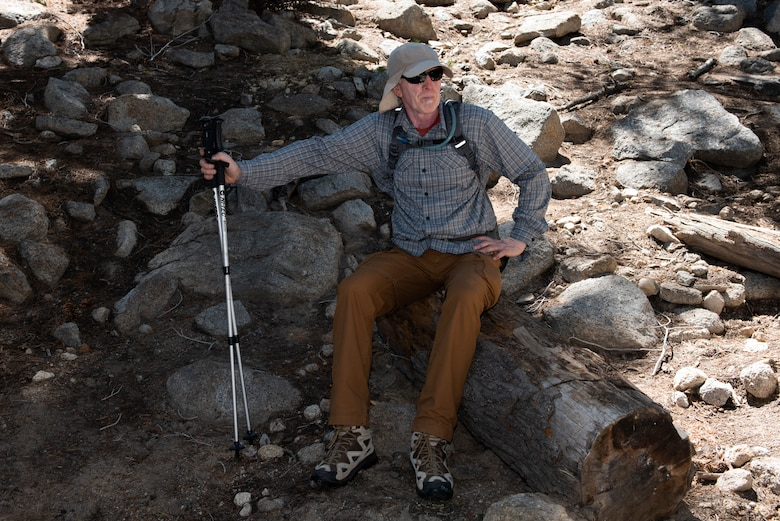 Retired U.S. Air Force Master Sgt. Terry Hendricksen, 60th Force Support Squadron outdoor recreation equipment repair technician, takes a break from hiking July 13, 2019, at Yosemite National Park, California. Hendricksen joined nearly four dozen Airmen from Travis Air Force Base, California, to hike to Cloud's Rest covering 14.57 miles as they climbed to 9,926 feet above sea level. The hike was organized to enhance the Airmen's physical, mental and spiritual resiliency. (U.S. Air Fore photo by Tech. Sgt. James Hodgman)