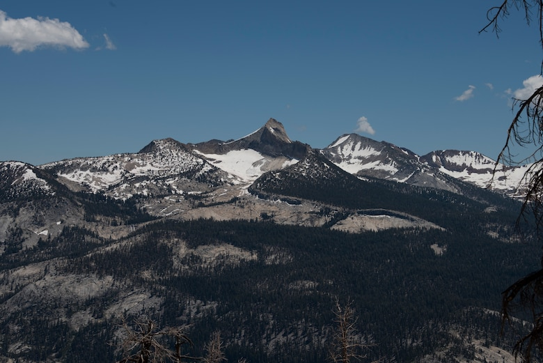 Several peaks and valleys are visible along the route of the trail leading to Cloud's Rest July 13, 2019, at Yosemite National Park, California. Nearly four dozen Airmen from Travis Air Force Base, California, hiked to Cloud's Rest covering 14.57 miles as they climbed to 9,926 feet above sea level. The hike was organized to enhance the Airmen's physical, mental and spiritual resiliency. (U.S. Air Fore photo by Tech. Sgt. James Hodgman)