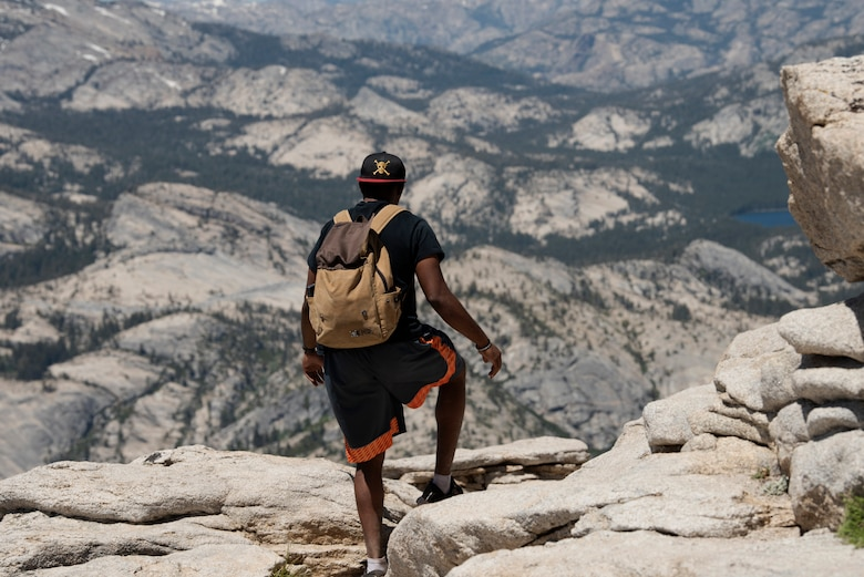 U.S. Air Force Capt. Ayodeji Alaketu, 60th Medical Operations Squadron family resident physician, prepares to hike down from the summit of Cloud's Rest July 13, 2019, at Yosemite National Park, California. Alaketu and 41 other Airmen from Travis Air Force Base, California, hiked to Cloud's Rest covering 14.57 miles as they climbed to 9,926 feet above sea level. The hike was organized to enhance the Airmen's physical, mental and spiritual resiliency. (U.S. Air Fore photo by Tech. Sgt. James Hodgman)