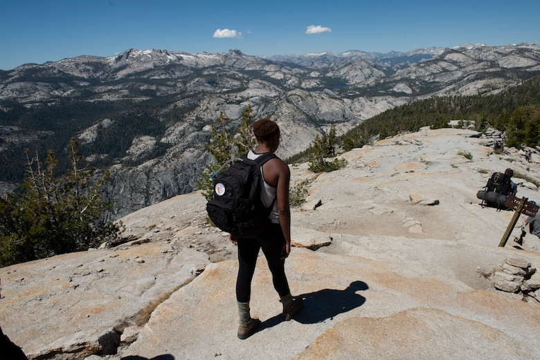 U.S. Air Force Senior Airman Lanisa Haynes, 60th Aerospace Medical Squadron medical technician, hikes down from the summit of Cloud's Rest July 13, 2019, at Yosemite National Park, California. Haynes and 41 other Airmen from Travis Air Force Base, California, hiked to Cloud's Rest covering 14.57 miles as they climbed to 9,926 feet above sea level. The hike was organized to enhance the Airmen's physical, mental and spiritual resiliency. (U.S. Air Fore photo by Tech. Sgt. James Hodgman)