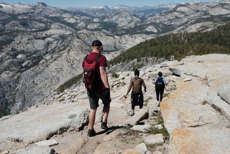 Airmen from Travis Air Force Base, California, work their way down the summit of Cloud's Rest July 13, 2019, during a resilience hike at Yosemite National Park, California. The Airmen hiked to Cloud's Rest covering 14.57 miles as they climbed to 9,926 feet above sea level. The hike was organized to enhance the Airmen's physical, mental and spiritual resiliency. (U.S. Air Fore photo by Tech. Sgt. James Hodgman)
